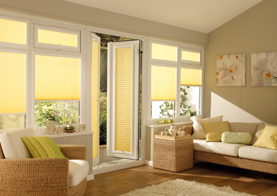 Yellow pleated shades with French Door